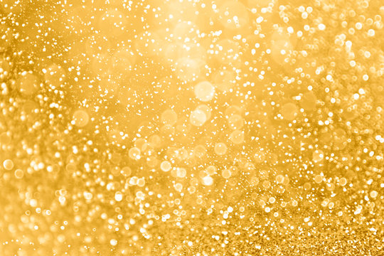 Gold glitter sparkle glam background texture for golden Christmas sparks, wedding anniversary or birthday