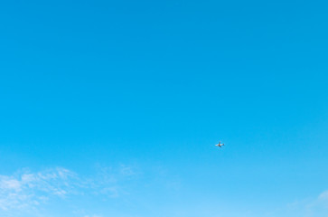 Passenger liner in the blue sky