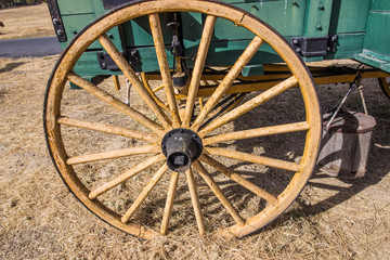 Old Weathered Wooden Wheel On Wagon