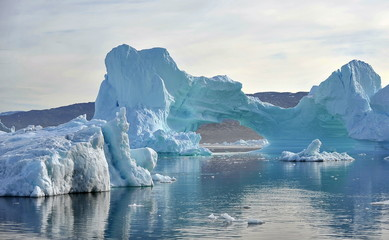 Icebergs drifting in the ocean.