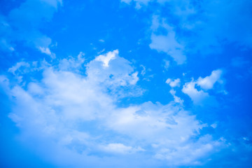 Sky on day time with clouds and deep blue background.