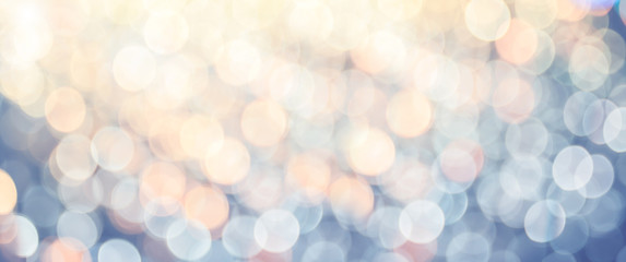 Banner size of Abstract pastel blue orange and yellow bokeh light background.light show festival at...