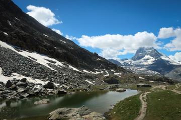 Scenic bright view of Matterhorn and clouds around, Swiss Alps near Zermatt