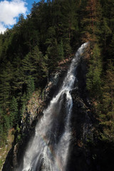 Scenic waterfall in Swiss Alps near village of Zermatt