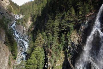 Scenic waterfall in Swiss Alps near village of Zermatt