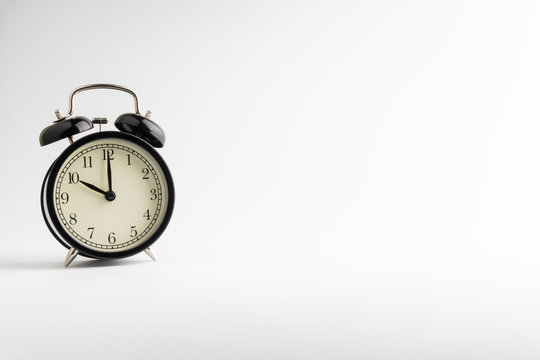Alarm clock isolated on white background with selective focu