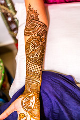 indian bride's hand with mehndi tattoo. Hand of Indian bride with henna tattoos