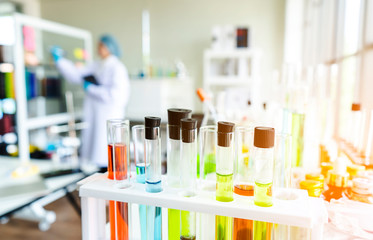 image of scientist or student with equipment and science experiments on laboratory,microscope for chemistry biology test samples,examining liquid,Scientific,healthcare research concept,blur,copy space