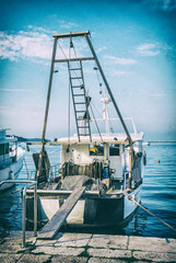 Fishing boat with nets in port, Porec, analog filter
