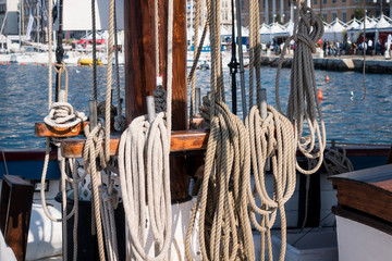 Detailed of rigging, bow and boom and the textures of rope and wood.