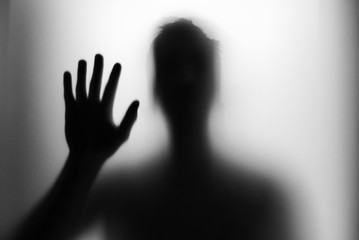 silhouette of hand on black background