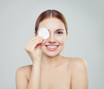 Happy model woman with cotton pads. Skincare, facial treatment, cosmetology, beauty and spa