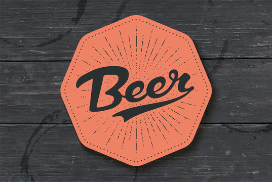 Coaster for beer with hand drawn lettering Beer. Monochrome vintage drawing for bar, pub and beer themes. Color coaster for placing a beer mug or a bottle over it with lettering. Vector Illustration