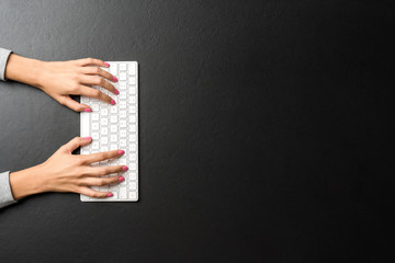 Woman using computer keyboard