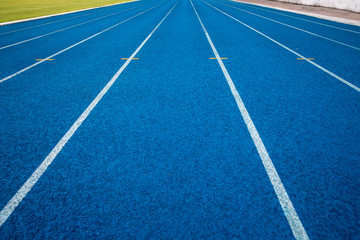 Blue running track in stadium. rubber running tracks in outdoor stadium.