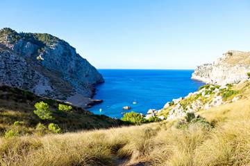 Secret beach - wild coast of Mallorca, Spain, Balearic Islands. Artistic sunrise and dusk landascape.