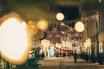 Graz city streets advent Christmas decorations by night. Shot between Christmas lights.