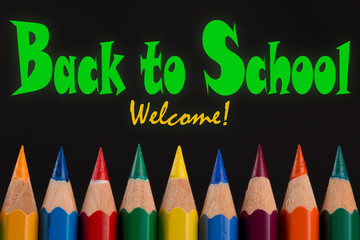 Back to School welcome, quote on Tips of Colored pencils, black background.