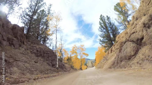 Wall mural Driving on small mountain dirt roads from Colorado Springs to Cripple Creek in Autumn.