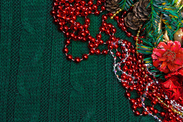 Xmas background with red decoration, green branch