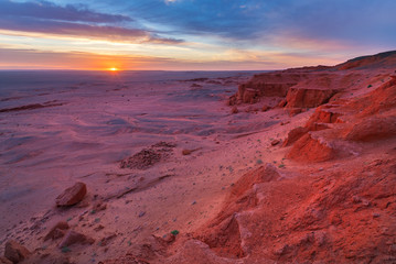 Photo of the Flaming cliffs in Mongolia, found in the Gobi Desert region taken during dawn