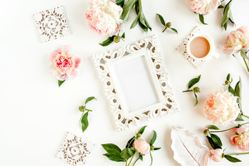 Carved, white frame decorated of beautiful pink peonies on white background. Flat lay, top view. Valentine's background. Floral frame. Peony texture.
