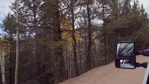 Wall mural Slow motion. Driving on small mountain dirt roads from Colorado Springs to Cripple Creek in Autumn.
