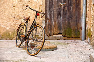 Papiers peints Velo Old retro bicycle on vintage street in Croatia background aged