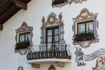 Traditional ornamented painted facade and balcony of Tyrolean building in Seefeld
