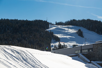 Winter sport region Seefeld with ski traces in the snow and view to ski lift on Gschwandtkopf