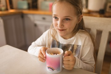 Girl holding a cup of marshmallows