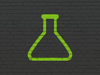 Science concept: Painted green Flask icon on Black Brick wall background