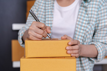 hands writing on parcel box, online business, prepare before delivery