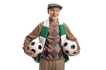 Senior soccer fan holding two soccer balls