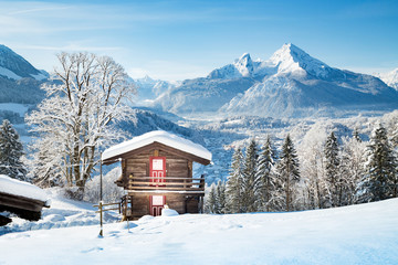 Rustic mountain cabin in the Alps in winter