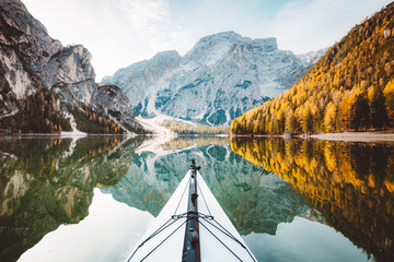 Kayak on a lake with mountains in the Alps