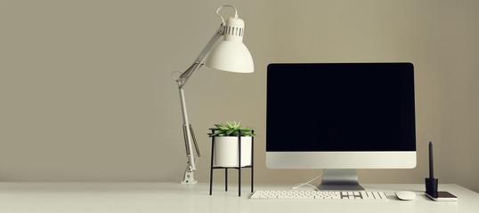 Designer workspace. Banner. Minimalistic home office. Blank screen desktop computer. Mockup desktop computer, lamp, graphics tablet, keyboard, mouse, pen, succulent plant on white desk. Copy space