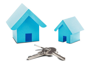 Estate concept, toy paper house and key on isolated white background with shadow. Idea for real estate concept, personal property and family house.