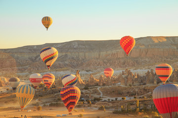Amazing sunrise over Cappadocia. Colorful hot air balloons.