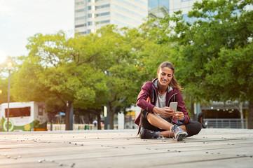Mature fitness woman using smartphone