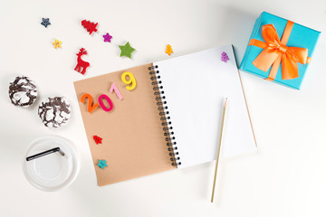New Year 2019. Opened note book and pen on white table. New Year's Resolutions concept. New Year background. Christmas holidays. Xmas. Goals for new year or Christmas. Christmas wish list.