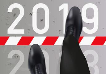 Carte de vœux 2019 montrant un homme vue du dessus, qui franchit une ligne symbolisant le passage à la nouvelle année