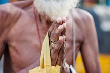 Senior male hands in namaste mudra