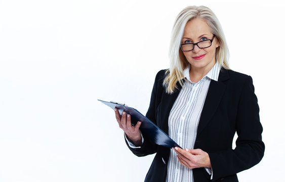 Business woman in white shirt holds pen and folder with files isolated on white background