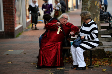 Participants wear costumes ahead of the annual Bonfire Night festivities, in Lewes