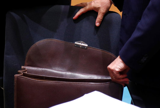 Italy's Economy Minister Giovanni Tria opens his briefcase during a euro zone finance ministers meeting in Brussels