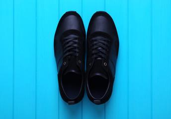 Men's sport shoes оn wood