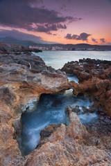 Amazing hidden beach and rocks in Milatos, Crete, Greece during sunset.