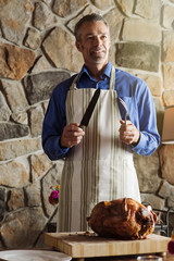 Man with roast turkey