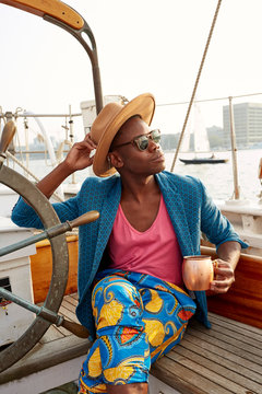 Man sitting on a boat with a drink